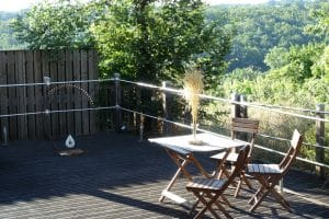chateau_feely_tasting_room_deck_with_sculpture1080